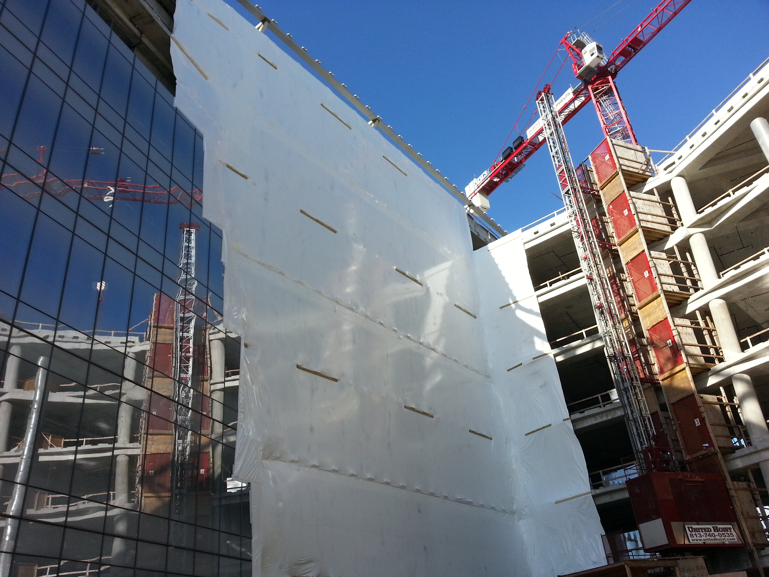 Curtainwall Delays Needed Shrink Wrap Containment